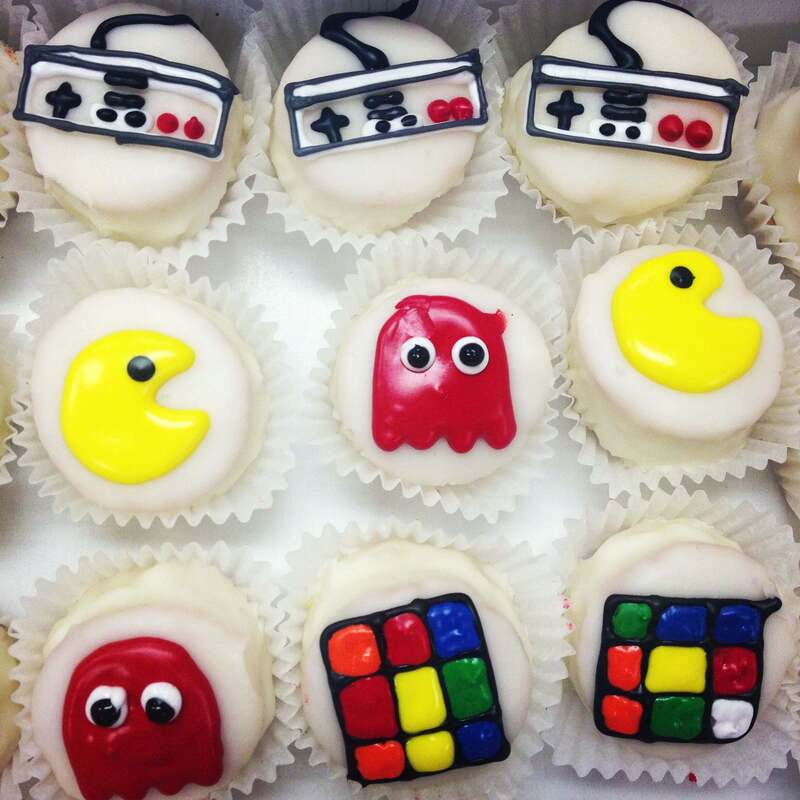 80s themed birthday petit fours decorated with pac man and rubix cubes