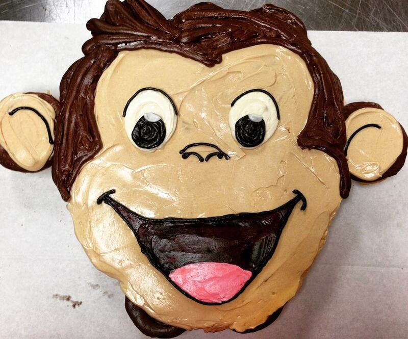 Cupcake pull-a-part cake decorated like Curious George