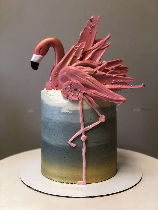 Tall birthday cake with flamingo made of chocolate