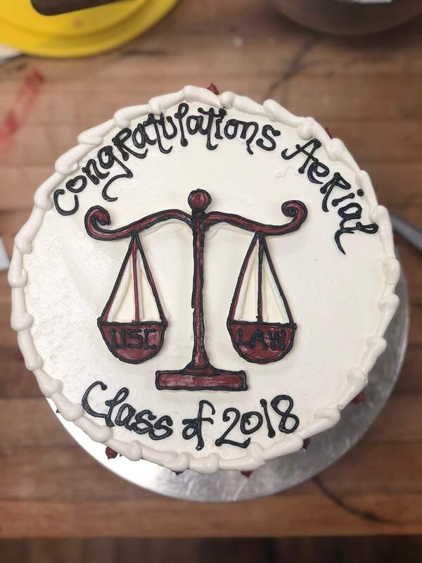 Law school graduation cake with scales of justice
